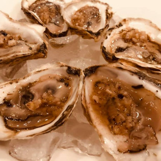 oysters on the half shell at max of eastman place