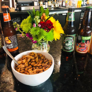 beer and bar snacks at the lounge at Max of Eastman Place